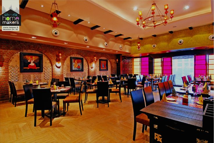 This picture speaks for itself. A warm and lovely restaurant with a lot of ample space and colourful interiors.  Find more at www.homemakersinterior.com