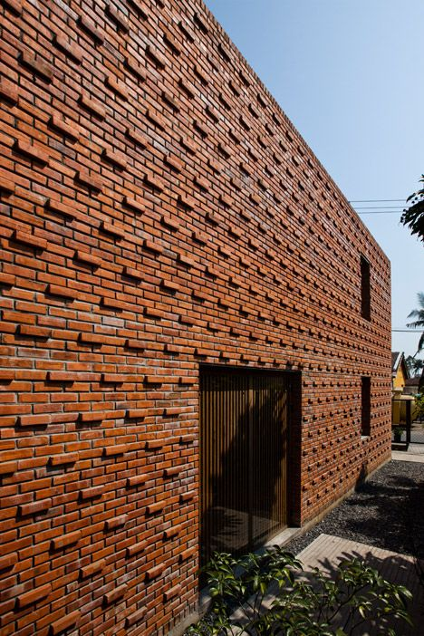 Perforated brickwork used to renovate house in Vietnam