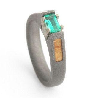 Emerald Engagement Ring with Sandblasted Titanium and Oak Wood Inlays.