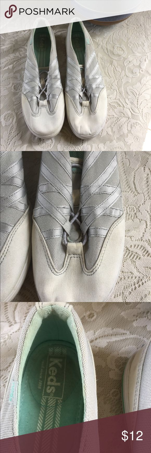 Keds slip on tennis shoe with no toe laces SZ 10 Keds slip on tennis shoe with no toe laces SZ 10.  White top with gray background and sliver stripes.  These are slip Keds.  Gently Used and in good condition. Keds Shoes Sneakers