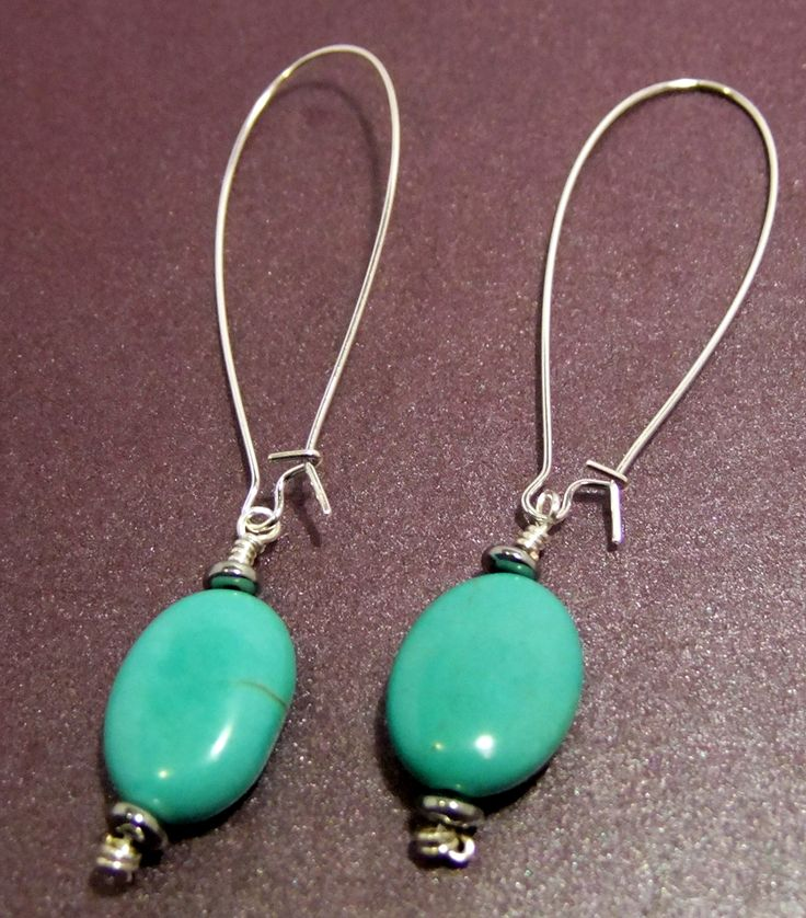 Simple and elegant, turquoise ovals hand wired with sterling silver earrings.