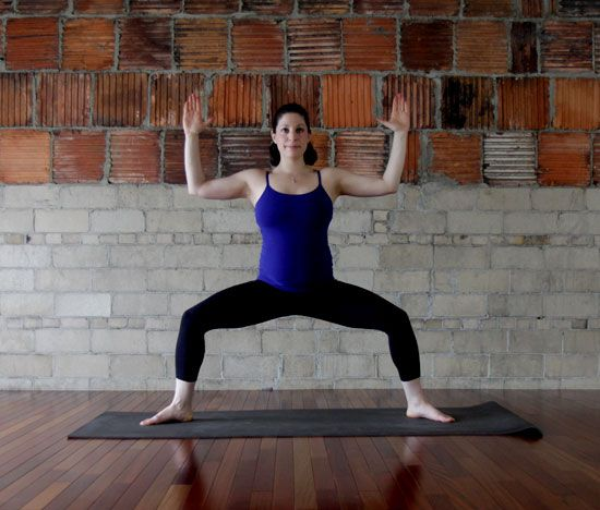 The Goddess pose is a classic go-to that's easy to master. Breathe in deeply and feel the lower-back pain relief!
