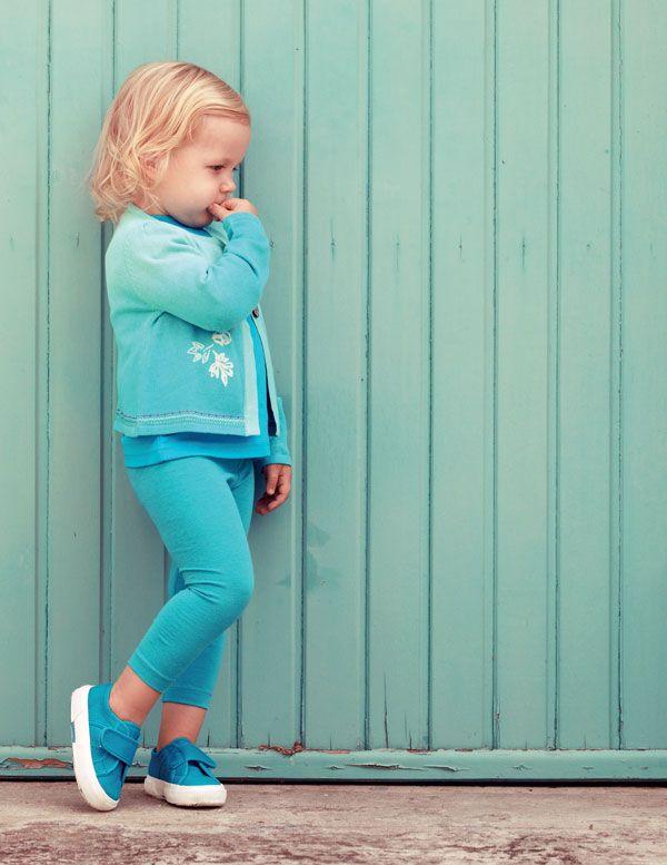 Niamh (2) struts her stuff in a turquoise long-sleeved T-shirt from Lief @ Kinderfli, tights from Pick n Pay Clothing and Kenzo cardi with ombre and embroidery detail, from Jelli. Her sneakers are from Superga.