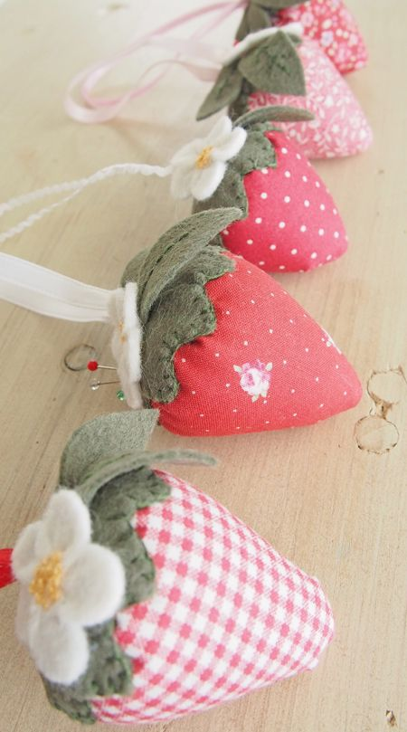 """pretty pin cushion strawberries.  Pretty by Hand fills her's [I do, too!] with walnut shells i.e. """"lizard litter"""" from the pet store.  ***I always always always line mine with white fabric to keep their colors bright and the oils/dust out of the outside fabric.  I <3 the weight!"""
