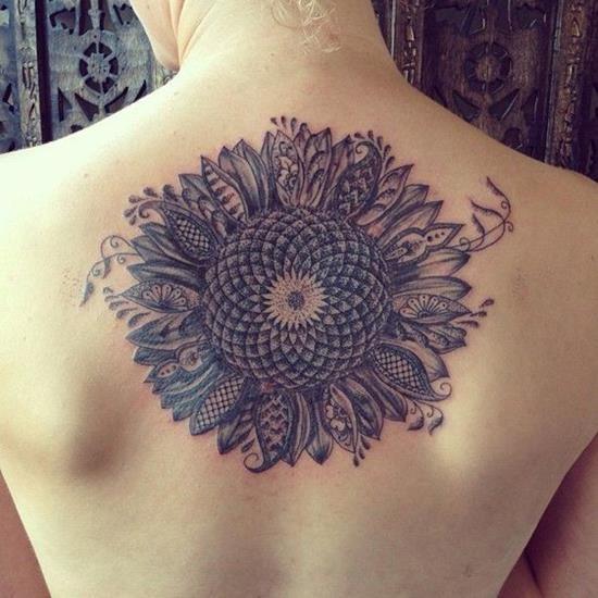 Center of sunflower with regular sunflower petals...