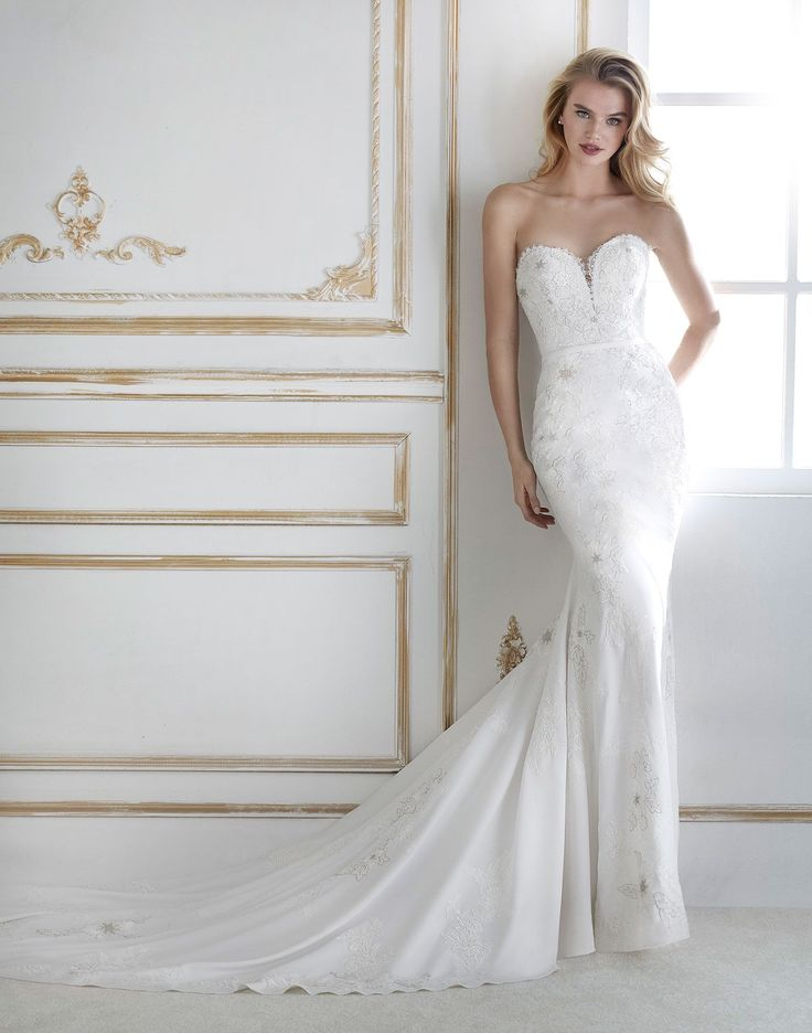 PADAU // A beautiful lace and crepe wedding dress with optional jacket creating and illusion neckline