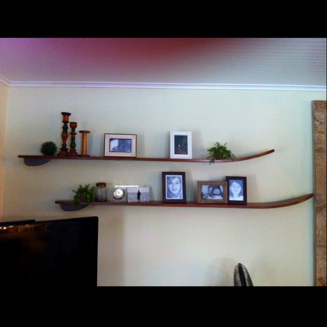 Water ski's I found in basement, stripped, stained mounted as shelfs in living room!! Bright yellow they was!!