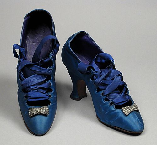 beautiful blue satin shoes with velvet ribbon laces and rhinestone bows on the toes.  (circa 1920-23)  France.