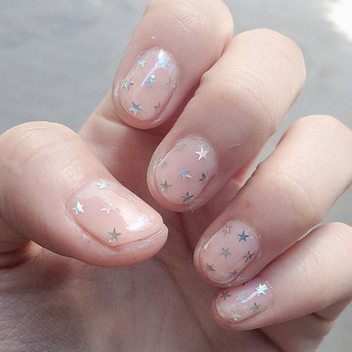 Nude nails with silver metallic stars nail art. #nailart #manicure #nailpolish