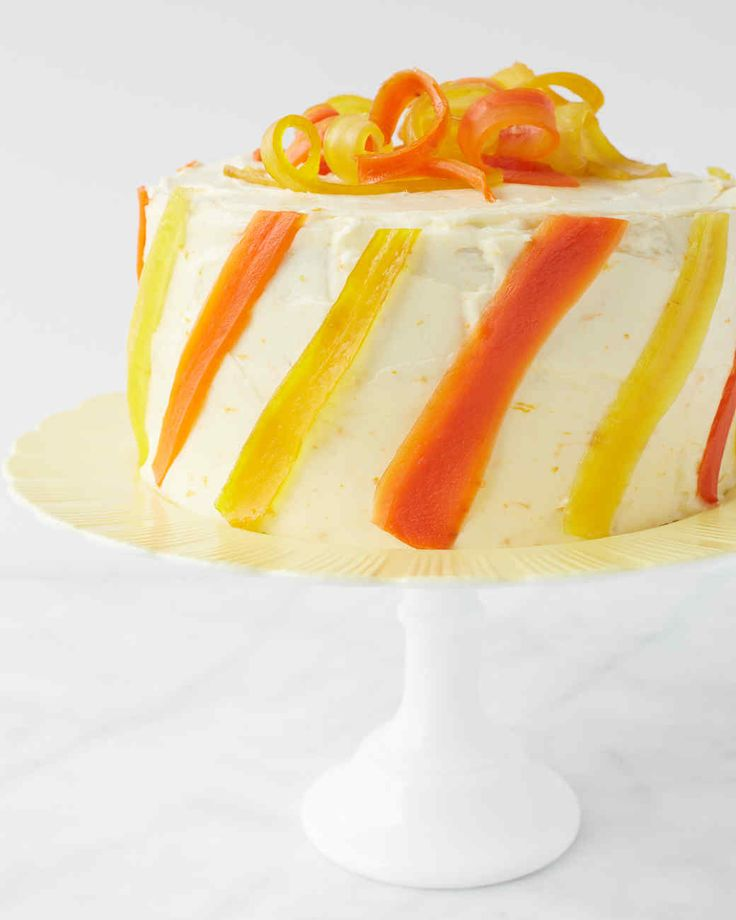 Carrot Ginger Layer Cake with Orange Cream Cheese Frosting | Martha Stewart Living - Take this springtime favorite to the next level with the bright additions of fresh ginger and orange zest, and tie up the whole creation with a candied-carrot bow.