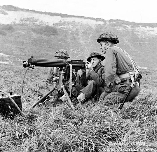 Soldiers of  Canadian Light Infantry (P.P.C.L.I.) firing a Vickers machine gun…