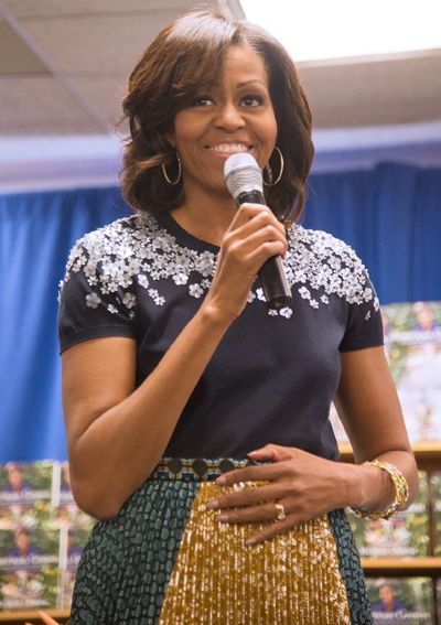 "Michelle Obama wore Tory Burch's ""MaryGrace"" top, a style that features floral embellishments around the neckline. #patternmixing"