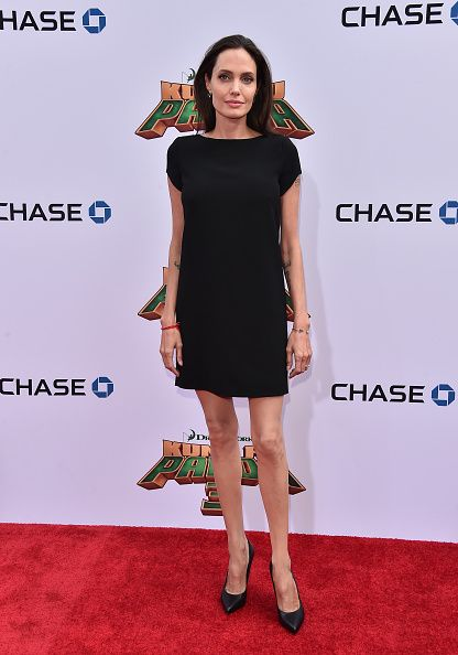 Skinny Angelina Jolie spotted on a shopping trip while Brad Pitt enjoys Kate Hudson's company