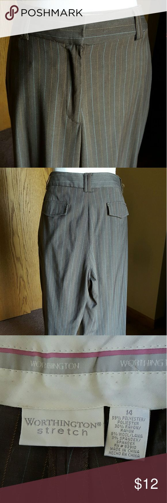 """Worthington slacks. Gray pinstriped. Size 14. Worthington, ladies size 14. Medium gray with pale blue and orange pinstripes. Faux back pockets with flats helps give a smooth look to the rear. Front pockets have been sewn shut to help flatten the tummy area.  At 5'3"""", average length is a bit too long for me and petite is too short for my liking, so most all pants listed have been carefully measured & hemmed. Hem length is hand sewn at 28"""". Rise is 10 1/2"""". Pictured for reference.  Loved…"""