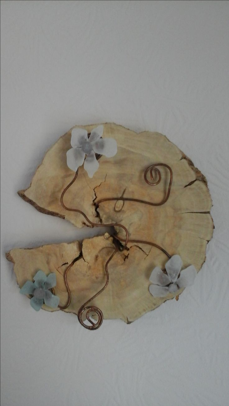 I thought this piece of wood was crying out for flowers to grow through it!  The flowers are made from sea glass and wire.