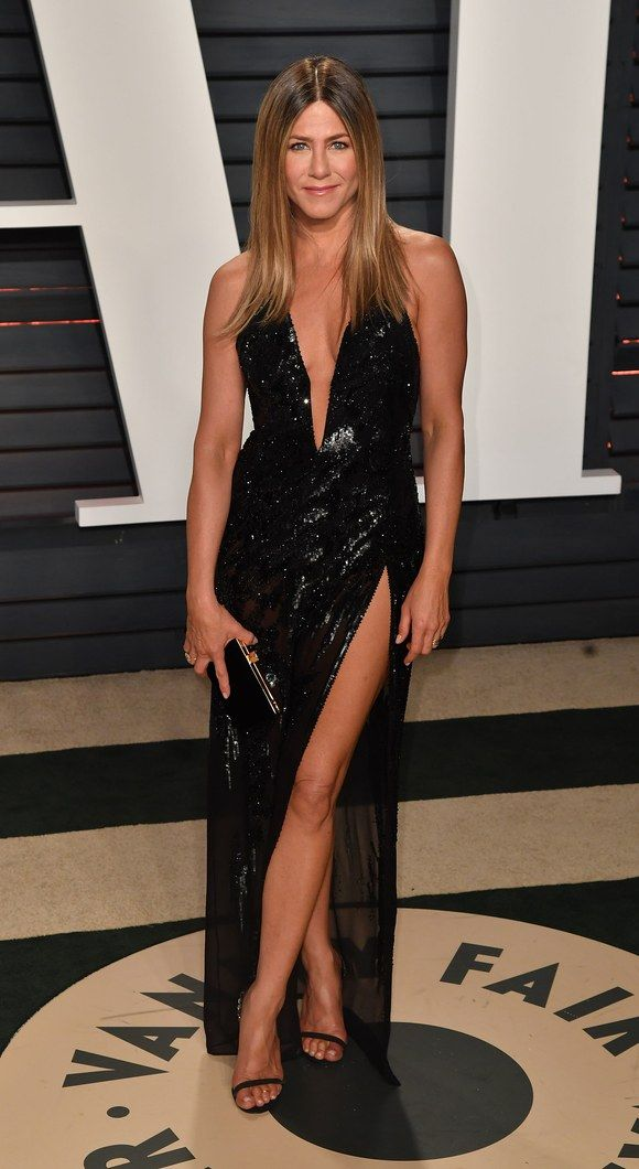 While Jennifer Aniston's Versace gown, with its sexy slit, at the 2017 Oscars had some recalling Angelina Jolie's right-leg moment at the 2012 show, there is another comparison that you might have missed. Apparently, Aniston wasn't the first celebrity to wear the beaded black dress—that would be Jennifer Lopez, who wore it for a concert with her ex-husband Marc Anthony at New York City's Radio City Music Hall back in August, People noted.