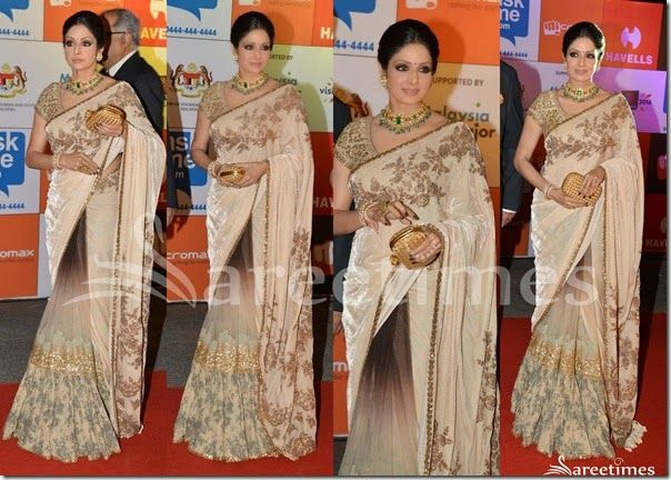 Bollywood and South Indian actress Sridevi in Sabyasachi saree at SIIMA 2014. She looked beautiful in tricolor embellished saree. Gold embellished applique patch and printed work all over saree,gold border. Paired with designer embellished short sleeves saree blouse. Heavy small embellished patch work all over blouse.