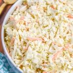 This simple coleslaw recipe is perfect for summer parties! You could even use our coleslaw dressing recipe for store-bought coleslaw mix.