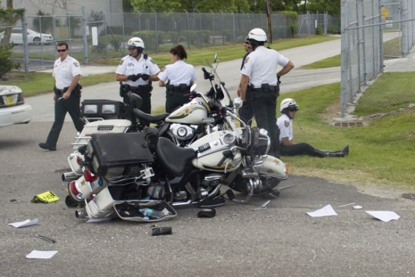 A Hillsborough County Sheriff's motorcycle following an accident while escorting US President Barack Obama to a speech about trade policies with Latin America at the Port of Tampa in Tampa, Florida, April 13, 2012.: Sheriff Motorcycles