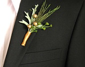 Wedding boutineers feather copper gold green boutonniere - set of 2. $22.00, via Etsy.