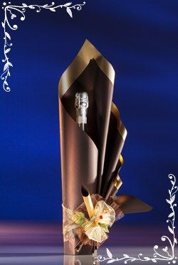 Wine bottle wrapped in glossy paper:
