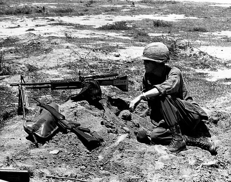 https://flic.kr/p/f7bKy9 | 25 Aug 1965, Vietnam - Private First Class John Lakey, with M60 machine gun and M16 rifle, keeps a watch for possible Vietcong as other members of his company dig in | 25 Aug 1965, Vietnam - Private First Class John Lakey, with M60 machine gun and M16 rifle, keeps a watch for possible Vietcong as other members of his company dig in. --- Image by © CORBIS