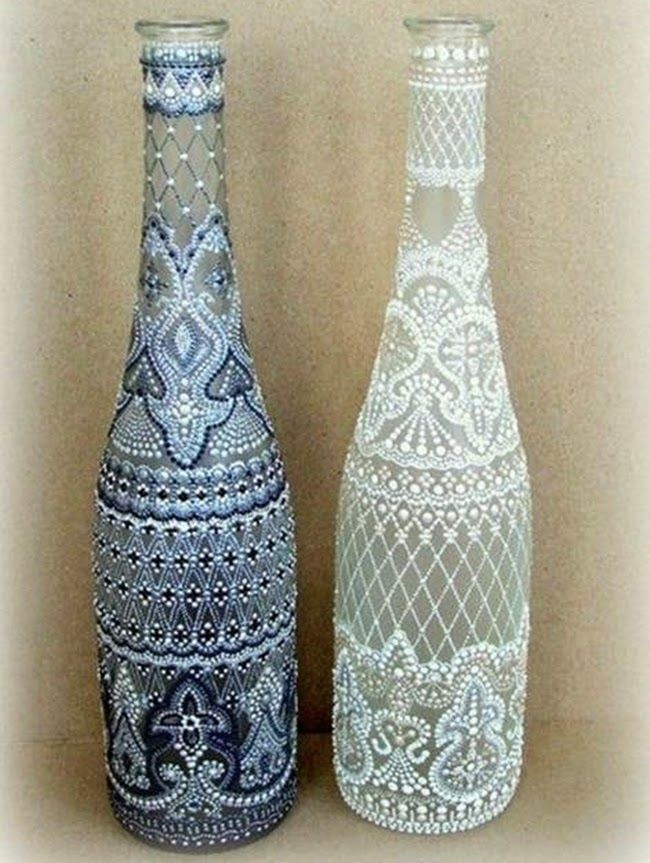Map out intricate patterns using graph paper, then apply puffy paint to your recycled wine bottle. (Source site is in Hungarian.)