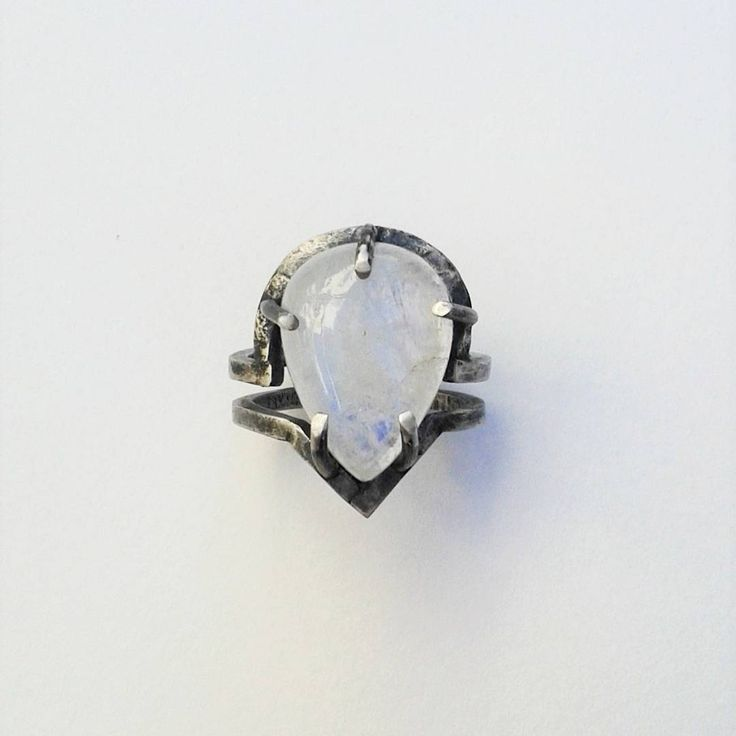 Sterling silver ring set with moonstone. Heavily oxidized and distressed.
