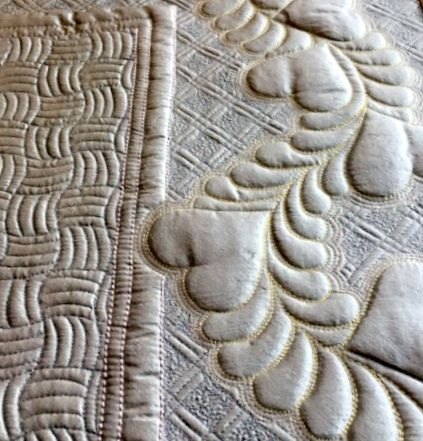 """Close up of """"High Tide"""" feathers border with heart motifs from the Ultimate Borders collection. https://www.cindyneedham.com/collections/stencils"""