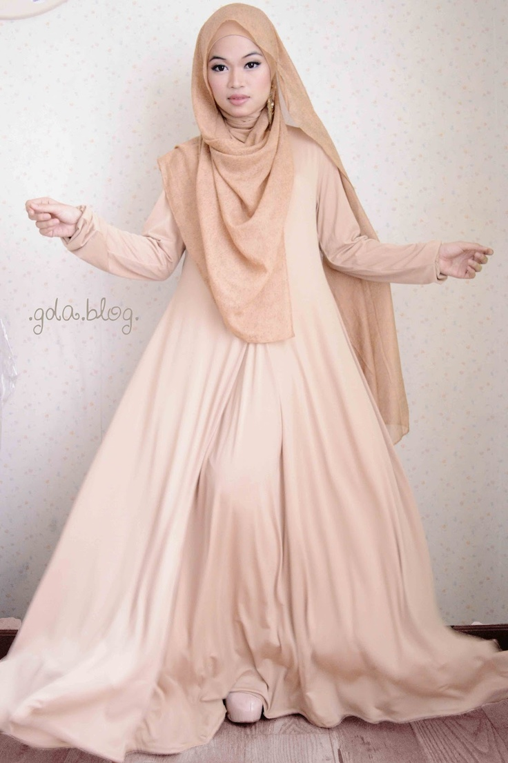 Cream coloured maxi dress with hijab.
