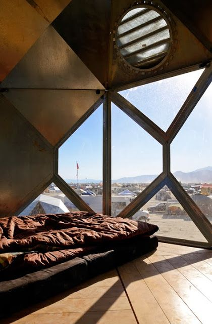 This is Black Rock City Blog - what!!?? This guy took the dome/hexayurt idea and put it on stilts, with windows, and a kitchen and... awesomeness!