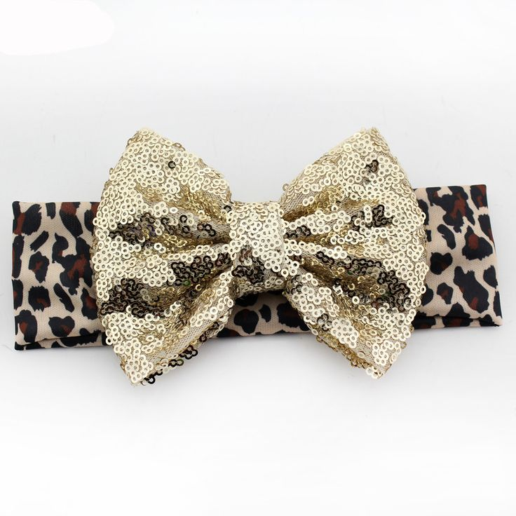"A headband with a little extra sparkle! - bow size - about 5"" - headband size - about 15"""