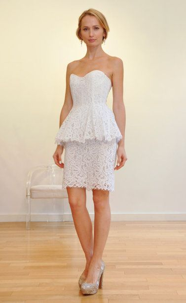A structured dress with a lacey peplum looks sophisticated and works well for a city hall wedding or as a wardrobe change at your reception.