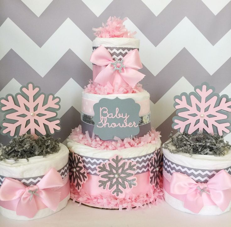Chevron Winter Wonderland Diaper Cakes, Winter Wonderland Baby Shower Decorations, Snowflakes, Pink and Gray by AllDiaperCakes on Etsy https://www.etsy.com/listing/255341372/chevron-winter-wonderland-diaper-cakes