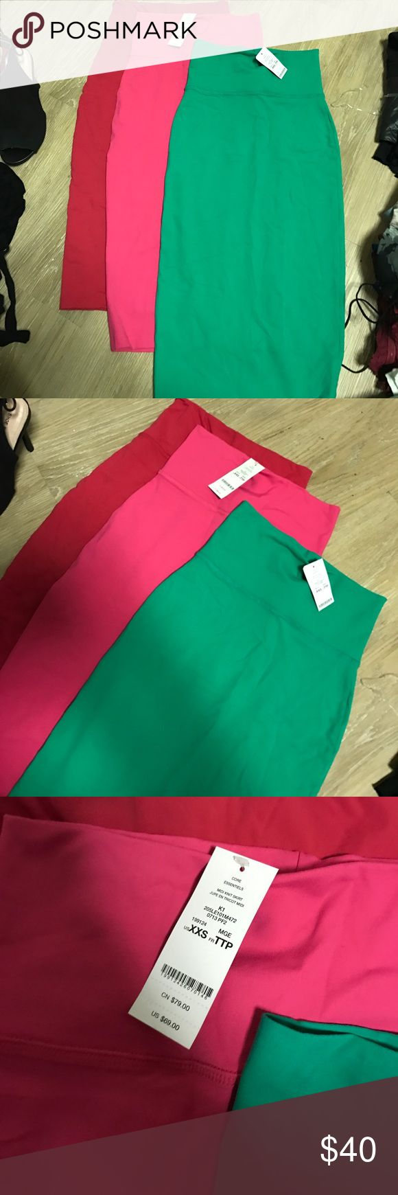 3 for 1 !!! High waisted stretchy tube skirt These will hug every curve !! Such cute colors for the summer - brand new - red pink and mint bebe Skirts Midi