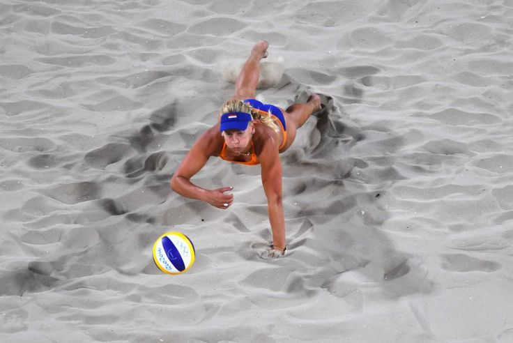 Marleen van Iersel of the Netherlands dives for the ball during the Women's Beach Volleyball preliminary round Pool F match against Olaya…