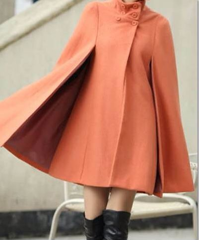 The #Cope - Coat and Cape all in one. Black and Coral in stock. FB.com/shopilltheory #customcoap