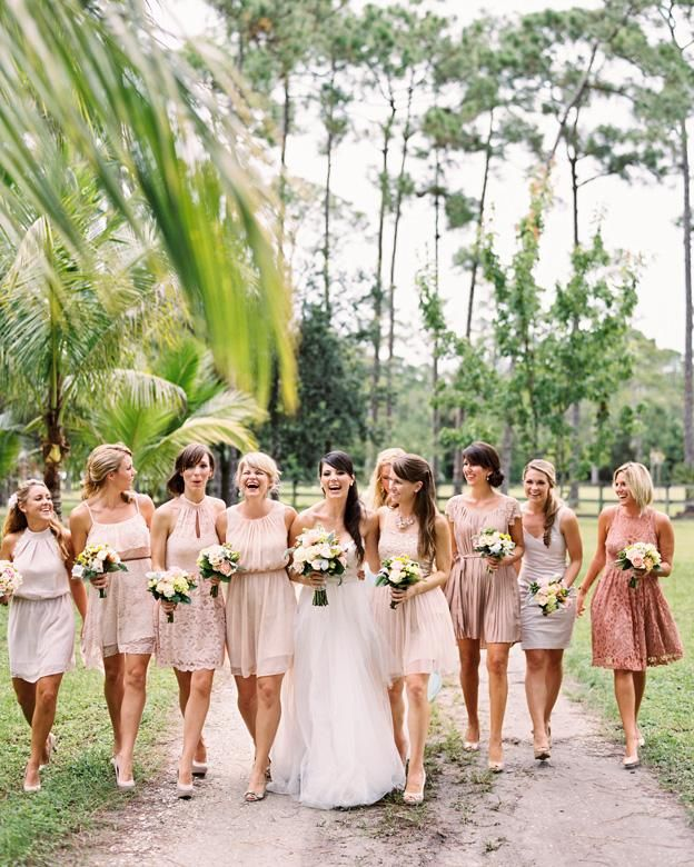 bridesmaids Blush Champagne pale pink bridesmaid dress walking outside linked arms different bridesmaids styles spring bouquets bridesmaids walking