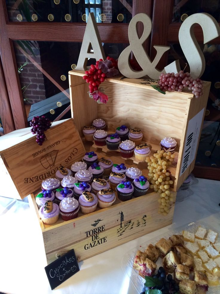 Vineyard theme bridal shower! Ask for wine crates from your local wine store and use as a cupcake display! I did this for my future sister in law, who planned to honeymoon in Napa #personal #wine #winetheme #bridalshower