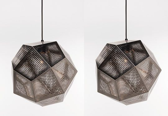 this lamp looks like a grate. It is made from metal and has clean, sharp edges. The lamp is not a particular shape but a 3D version of a mutated cube