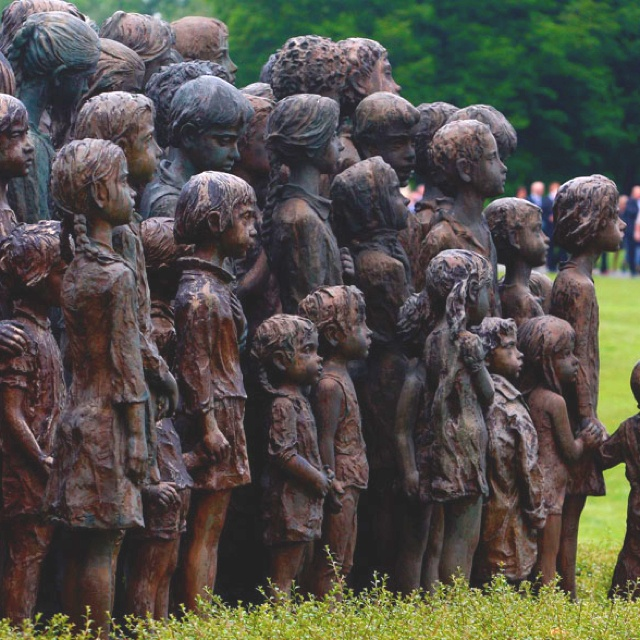 A woman passes behind the memorial dedicated to the local children who perished in Nazi concentration camps, during a remembrance ceremony honouring the 70th anniversary of the destruction of the village of Lidice by the German Nazi troops, in Lidice, Czech Republic, 10 June 2012.