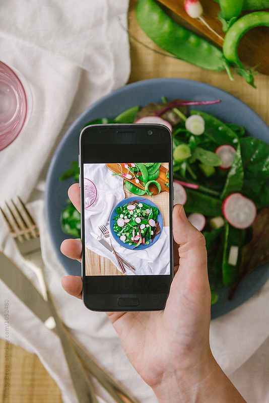 Woman takes a photo on her smartphone of her salad by Kirsty Begg for Stocksy United food, from above, hand, healthy eating, lettuce, mangetout, mobile, mobile phone, organic, overhead, pea, photo, radish, salad, scallion, smart phone, smartphone, spring onion, summer, vegetable, woman