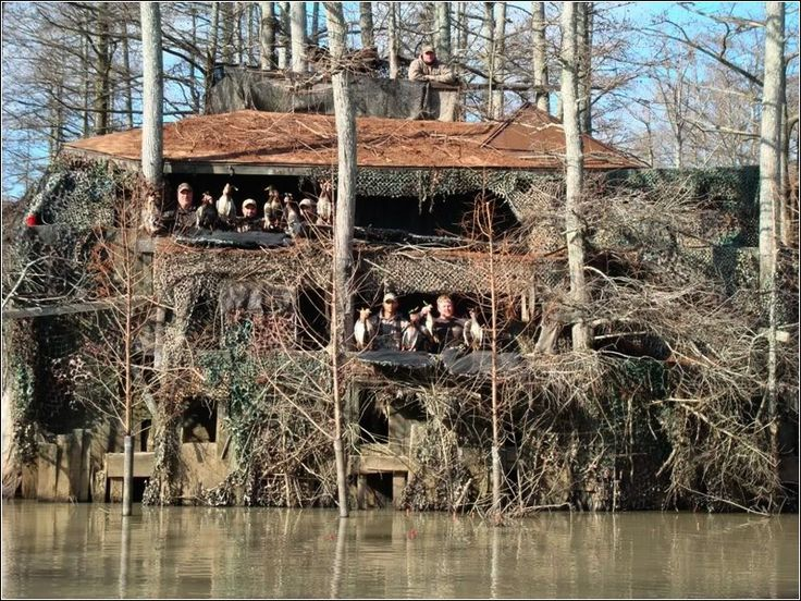 "Deluxe duck blind house-  ""2nd level has a full kitchen with fridge, 2 stoves, electricity for lights, living room with 2 couches and satellite TV, theater seats around the ""porch of the blind"" to sit 14 guys comfortably. A side porch has a running toilet, a stainless steel grill for cooking whole rib-eyes for lunch and a bar to make all the Mojos and margarita machine which are hardwired to car batteries. 3rd level is the ""crows nest"" with room for 3. It's about 25' up in the trees and most…"