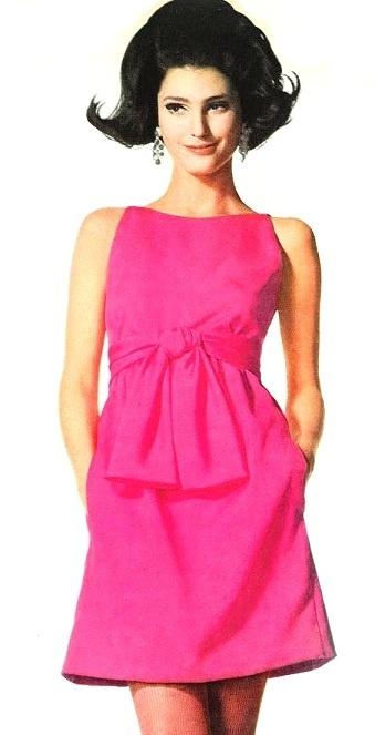 Benedetta Barzini is wearing a fuchsia crepe dress by Gino Charles, 1967