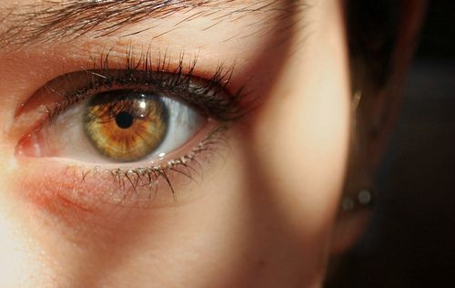 Hazel eyes are one of the least understood eye colors. This color is semi-rare and is a combination of several other colors including green and brown. Hazel eyes have less melanin than brown eyes, but more than blue eyes. Hazel eyes often appear to shift in color from brown to green. Hazel eyes are a combination of Rayleigh scattering, the principle that makes the sky and blue eyes appear blue, and melanin, the pigment that makes brown eyes brown.