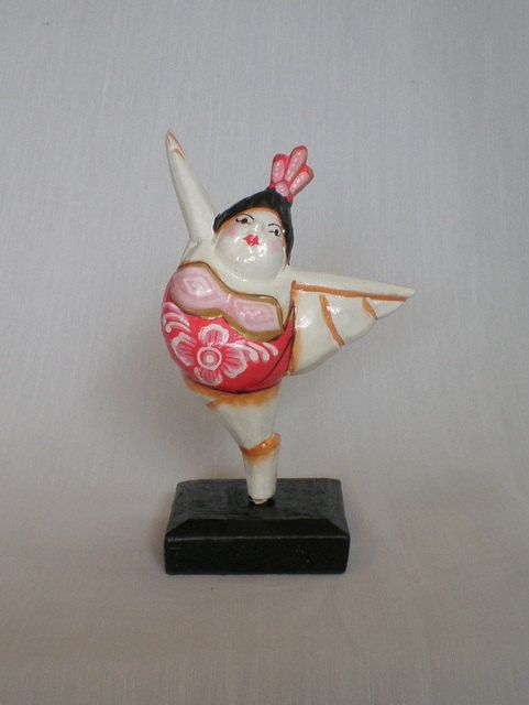 www.etsy.com/shop/ExtravaganzaBali  Wood carved dancer, painted with acrylic colors. High 16 cm.  High 6.30 inches.  $8.90 USD