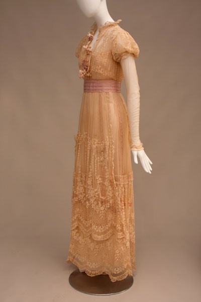"""Lucile. Dress worn by Billie Burke in """"The 'Mind the Paint' Girl"""". New York, 1912. Machine-made lace (Brussels point de gaze), silk faille, silk flowers, chiffon, and wire."""