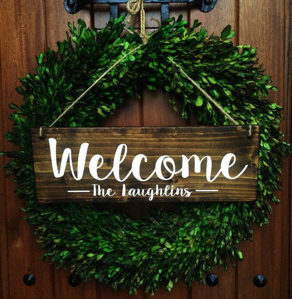 **Due to high order volumes, our current turnaround time is 3 weeks.***  *********************************************************************************  Welcome Wood Door Sign Personalized with Last name hanging with jute twine *WREATH NOT INCLUDED*  • Handmade, painted wood sign. Lettering is painted on. (No vinyl or stickers on sign whatsoever)   2 Font options available. See sample pics above for options.  • Measure approximately 5.5 x 16 (can vary up to 1/2)  • Made with new solid...