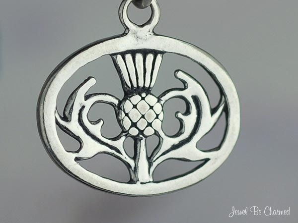 Scottish Thistle Charm Sterling Silver Oval Scotland National Flower. via Etsy.