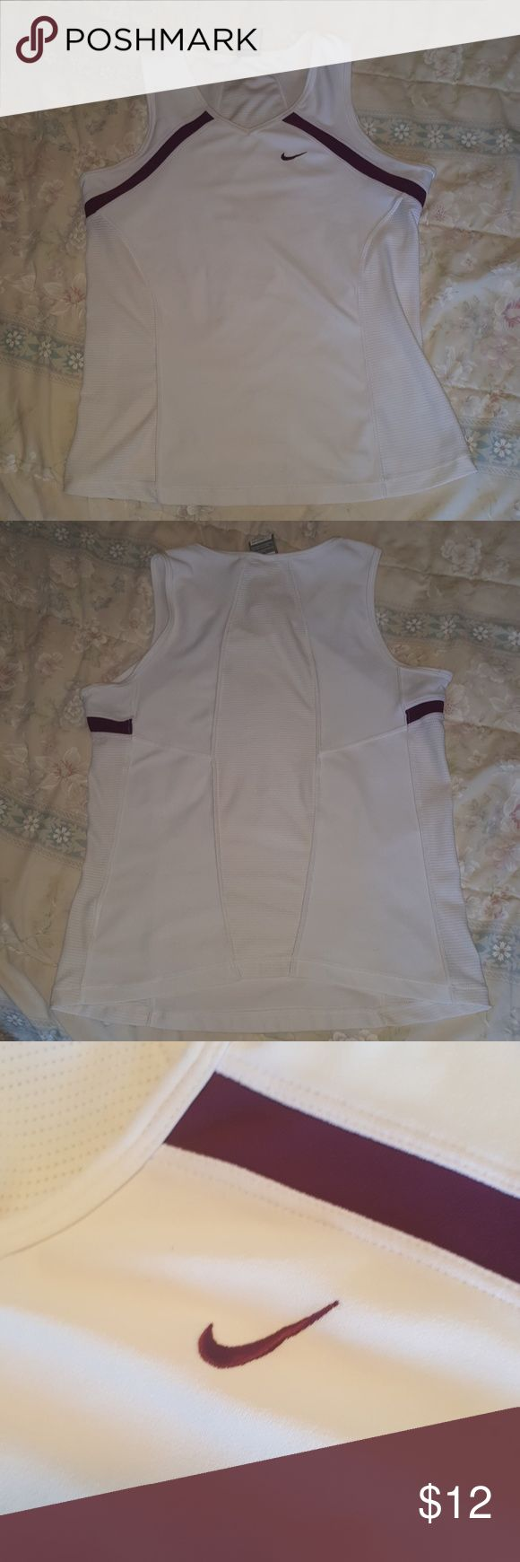 Nike tank top! It is a fitted medium nike tanktop. It would be go for working out or just wearing around. Its stretchy and comfortable and needs a good home! There is a very small light stain on the front of the shirt that is shown in the last picture, you can hardly see it unless you look really hard, but i just thought i would inform you. No ones liles getting unwanted suprises. Price is aleays negotiable with me. And if you have any questions i would be happy to anwser them. Nike Tops…